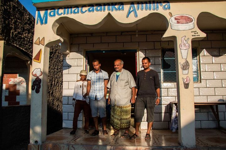 Yemeni business owners stand in front of their shop in Hargeisa. Yemeni migrants have been traveling to Somaliland for work o