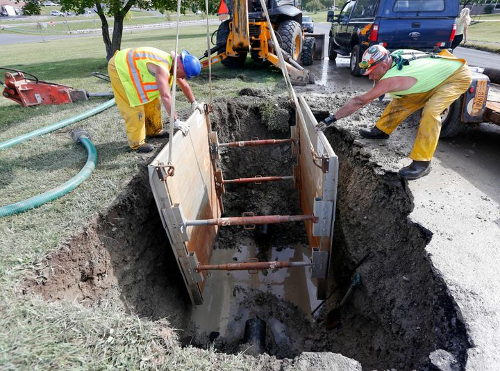 In this Sept. 21, 2015, photo, workers repair a water main break in Syracuse, New York. The U.S. has a large -- and growing -