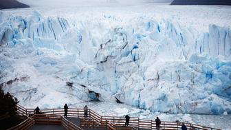 SANTA CRUZ PROVINCE, ARGENTINA - NOVEMBER 29:  The Perito Moreno glacier stands in Los Glaciares National Park, part of the Southern Patagonian Ice Field, on November 29, 2015 in Santa Cruz Province, Argentina.  Certain areas of glacial ice take on a bluish hue due to light refraction. The Southern Patagonian Ice Field is the third largest ice field in the world. The majority of the almost 50 large glaciers in Los Glaciares National Park have been retreating during the past fifty years due to warming temperatures, according to the European Space Agency (ESA). The United States Geological Survey (USGS) reports that over 68 percent of the world's freshwater supplies are locked in ice caps and glaciers. The United Nations climate change conference begins November 30 in Paris.  (Photo by Mario Tama/Getty Images)