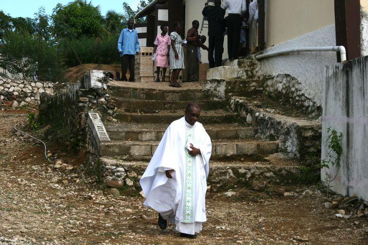 Father Joseph leaving Mass.