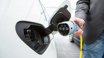 A driver charges a Volkswagen e-Golf electric automobile at a charging station outside the Volkswagen AG (VW) factory in Wolfsburg, Germany, on Friday, May 20, 2016. Volkswagen AG agreed to raise German workers' pay after labor leaders vowed that employees wont foot the multi-billion-euro bill to resolve its diesel-emissions scandal. Photographer: Krisztian Bocsi/Bloomberg via Getty Images