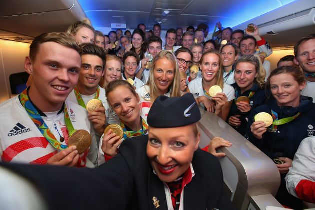 Gold medalists of Team GB pose for a selfie with a member of British Airways cabin