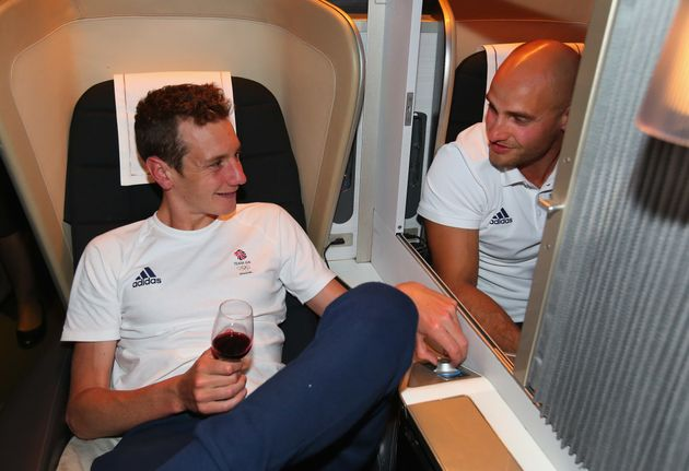 Alistair Brownlee (L) and Liam Heath of Great Britain chat during the Team GB flight back from
