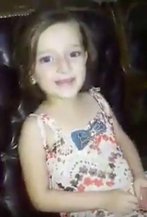The little girl is filmed happily