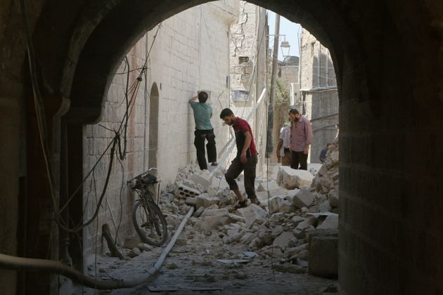 Residents inspect their damaged homes after an airstrike inrebel-held