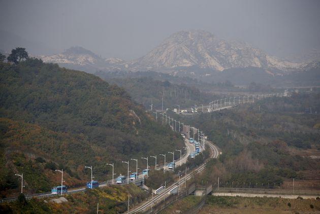 Buses transporting South Korean participants for a reunion travel on the road leading to North Korea's...