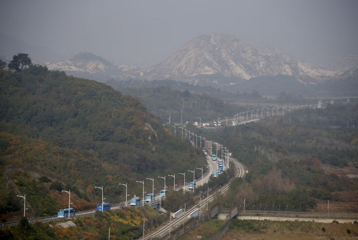 Buses transporting South Korean participants for a reunion travel on the road leading to North Korea's Mount Kumgang resort,