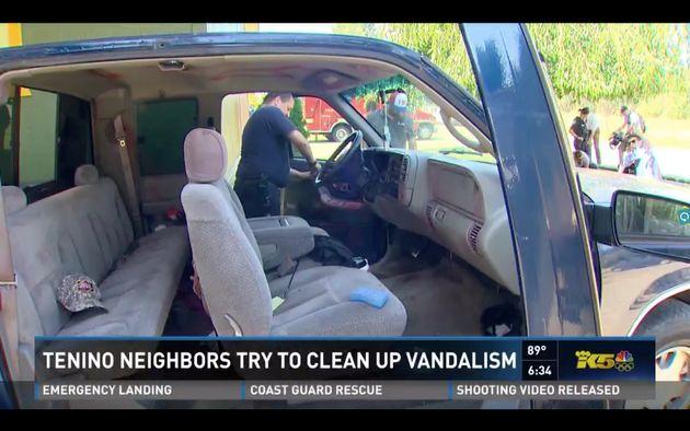 Local firefighter Mike Vanderhoof is seen replacing a door panel on a vandalized truck belonging to the