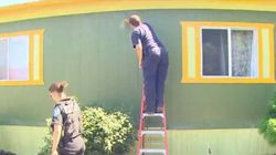 Community Cleans Up 'KKK' Graffiti On Family's Home Before They