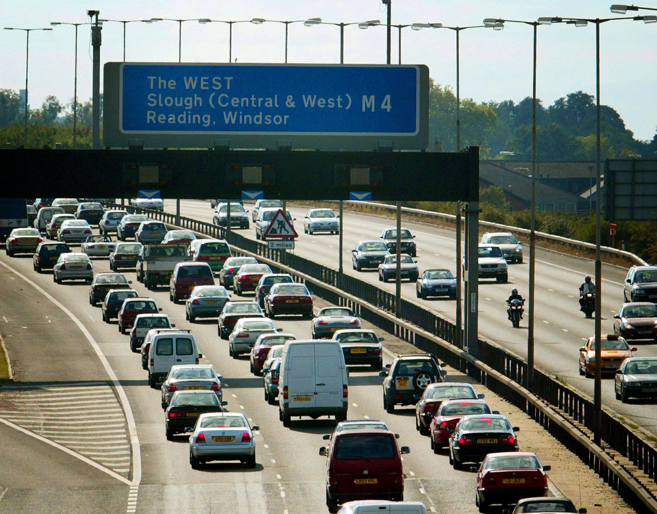 Queues of traffic head west on the M4 motorway just outside London as people head out of the capital...
