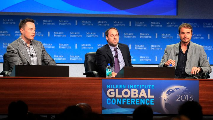 Elon Musk (L) and his brother Kimbal Musk (R), co-founder of The Kitchen Community, appear on a panel with interviewer Jeff S