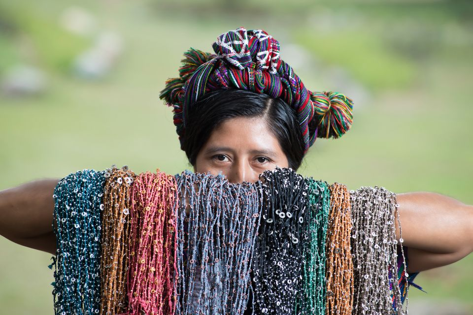 A Guatemalan woman holds up a selection of Wakami