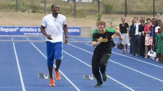 Prince Harry Gets Some Running Tips From Sprinter Usain Bolt, At 'The Usain Bolt Track' At The University Of The West Indies, In Kingston, Jamaica, During His Official Visit To Jamaica. (Photo by Julian Parker/UK Press via Getty Images)