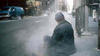 A homeless man, photographed in winter.