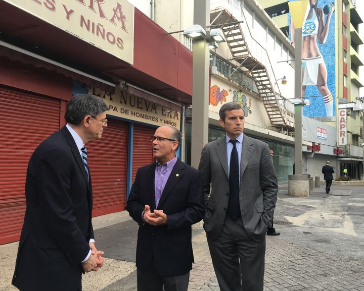 Antonio Weiss, at right, stands by as Treasury Secretary Jack Lew talks to the president of Puerto Rico's Chamber of Commerce, José Vazquez Barquet, in San Juan, Puerto Rico.
