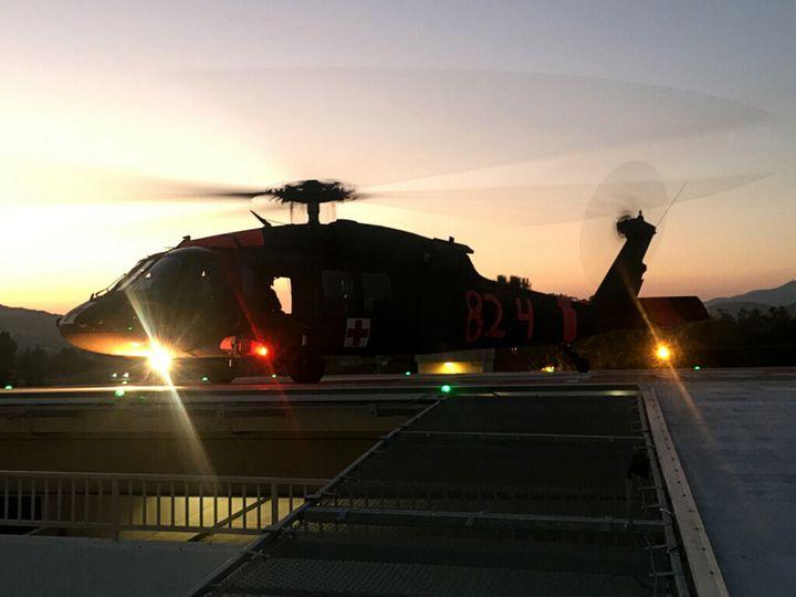 UH-60 MEDEVAC helicopter on the helipad at Sierra Vista Regional Medical Hospital at dusk