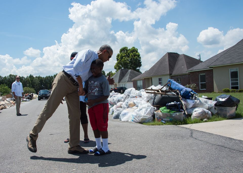 President Barack Obama speaks with residents as he tours a flood-affected area in Baton Rouge, Louisiana, on August 23, 2016.