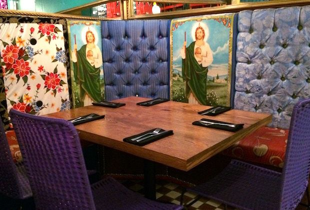 Kitschy religious decorations set the stage for tasty Mexican specialties at I Latina restaurant in Guadalajara, Mexico.&nbsp