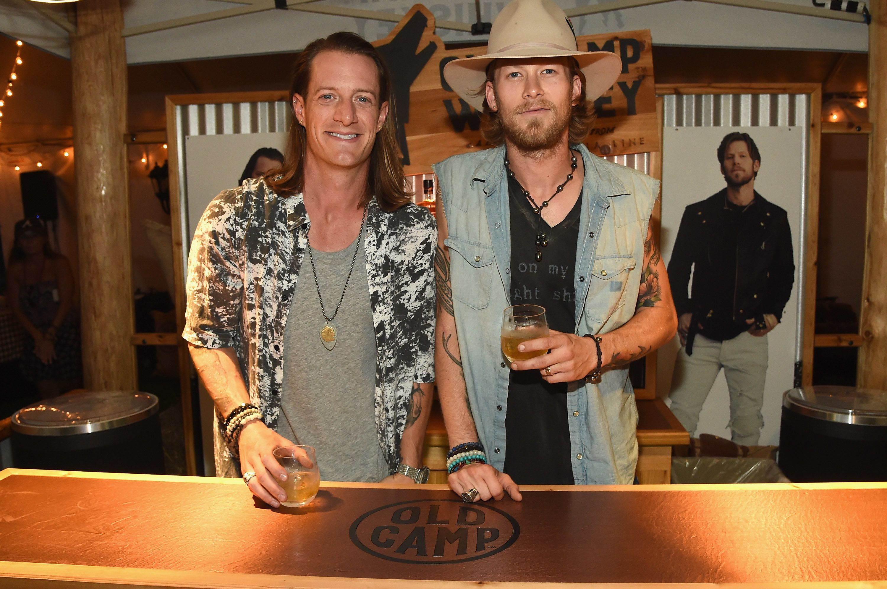 HOLMDEL, NJ - AUGUST 04:  Tyler Hubbard and Brian Kelley of Florida Georgia Line launch their Old Camp Peach Pecan Whiskey on August 4, 2016 in Holmdel City.  (Photo by Rick Diamond/Getty Images for Old Camp Peach Pecan Whiskey )