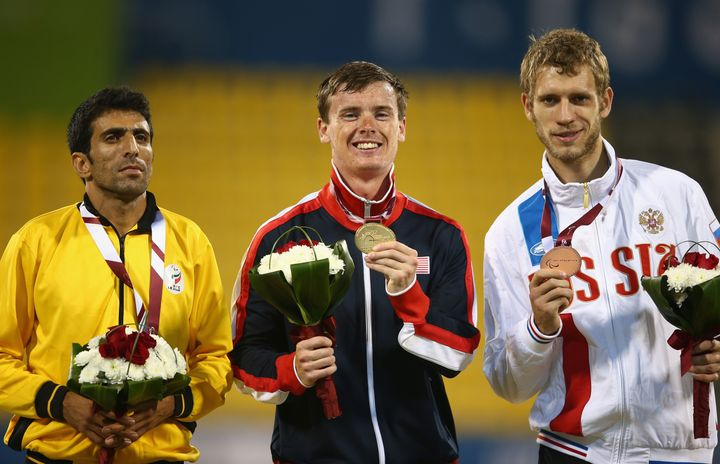 Michael Brannigan poses with his gold after the men's 1,500-meter T20 during the Evening Session on Day Four of the IPC Athle