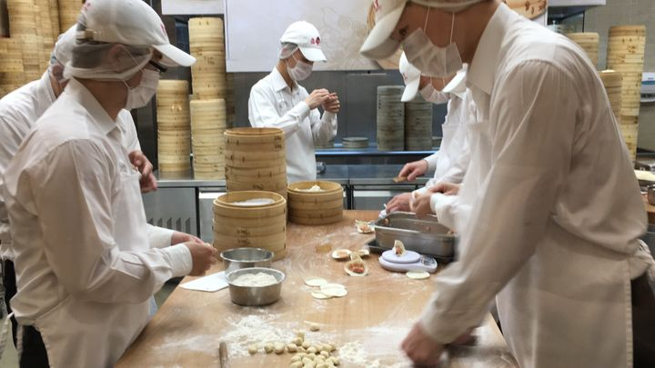 You can watch workers make the dumplings through a window.