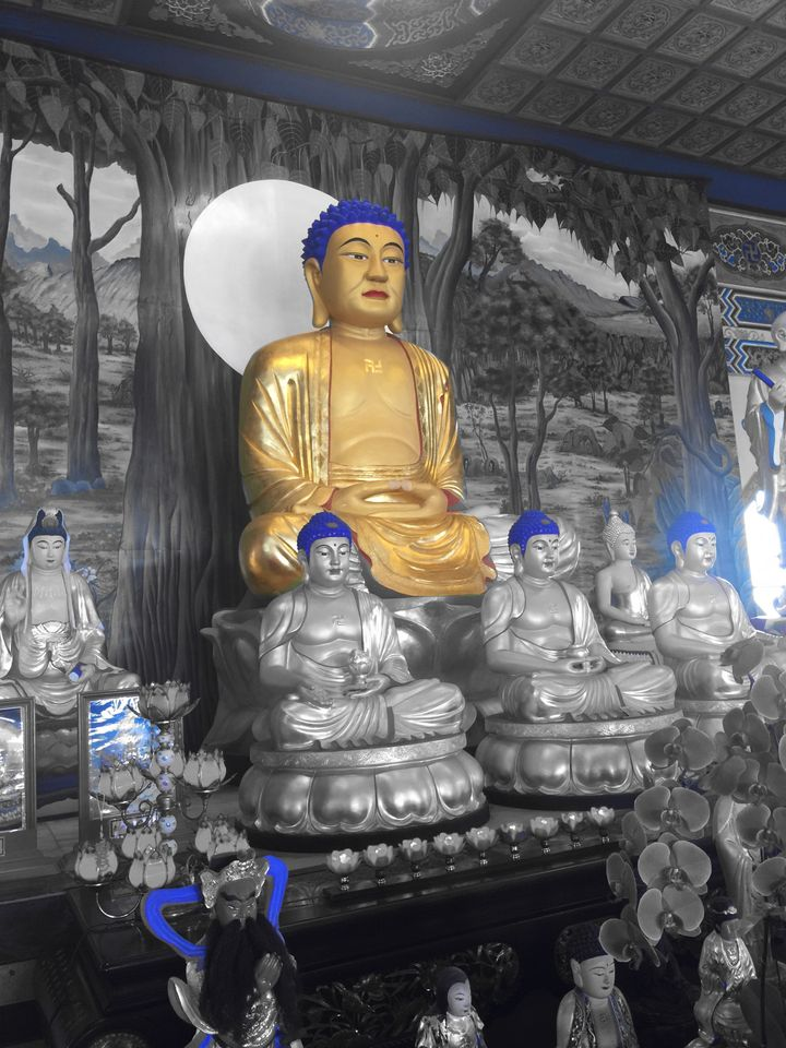 Some of the Buddhas in a temple. Edited with Vivv App.