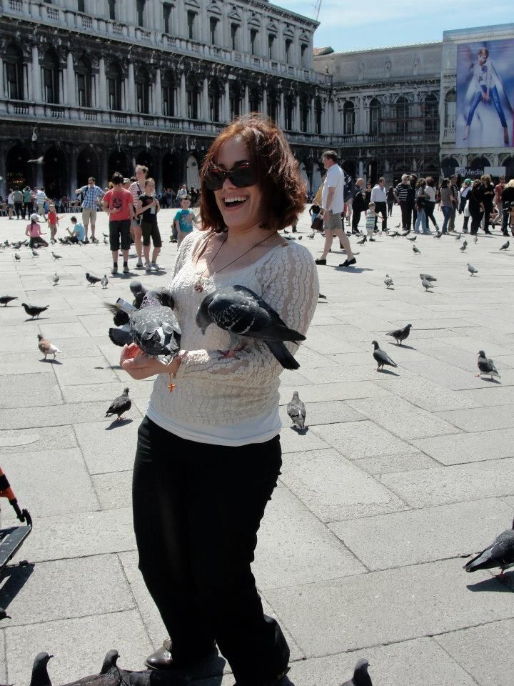 <p><em>Laurita enjoys a spontaneous moment while visiting Venice, Italy in May 2012.</em></p>