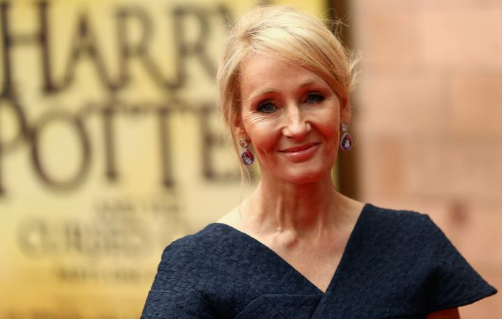 Author J.K. Rowling poses for photographers at a gala performance of the play Harry Potter and the Cursed Child parts One and