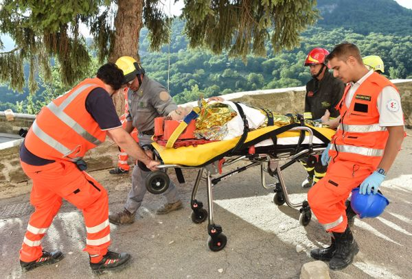 75-year-old Rocco Girardi is rescued from the ruins in Arquata del Tronto.