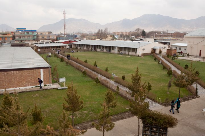 Students walk through campus at the American University of Kabul on March 31, 2012 in Kabul, Afghanistan.
