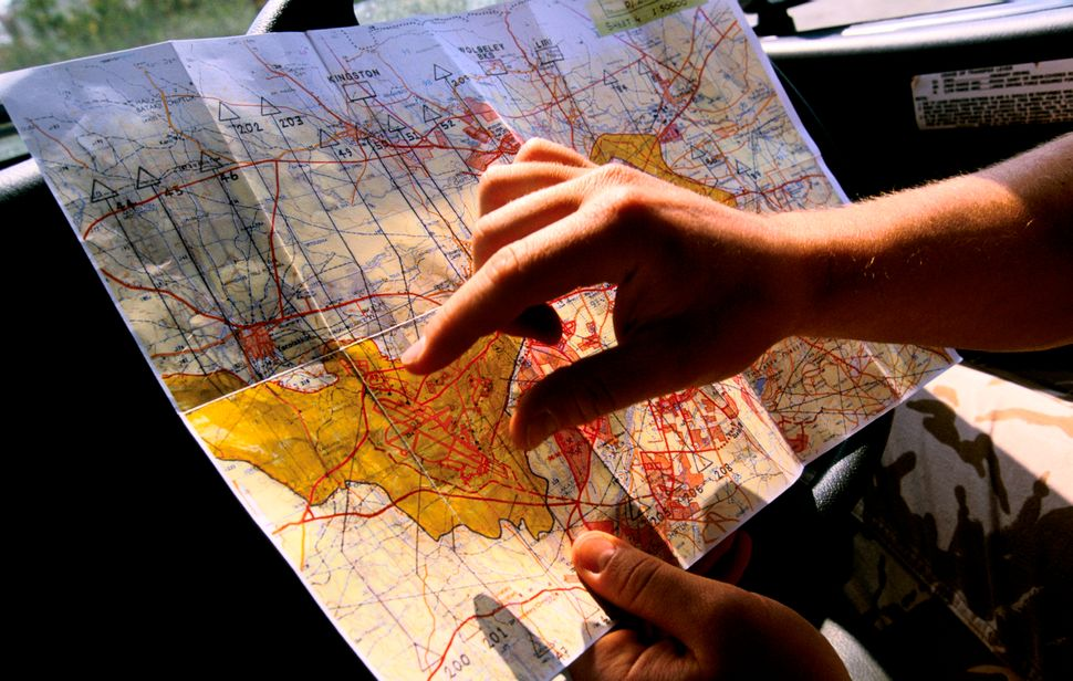 U.N. peacekeepers examine a map showing the Green Line, the border between northern Cyprus and southern Cyprus.