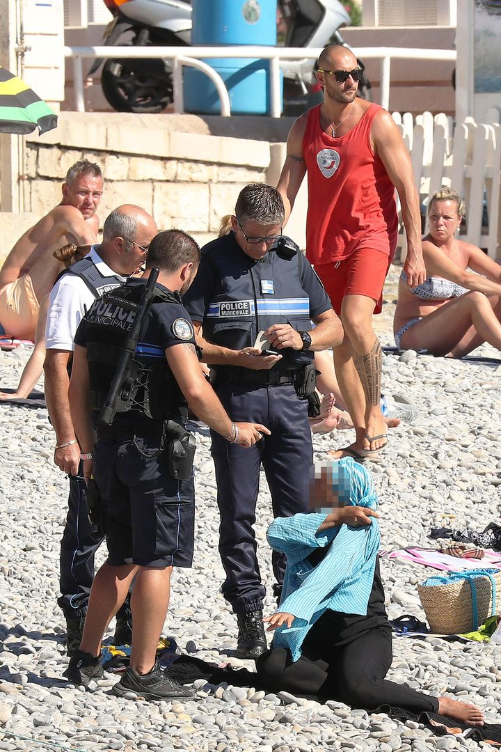 "One of the police is shown holding a notepad. Some women have already been <a href=""http://www.huffingtonpost.com/entry/"