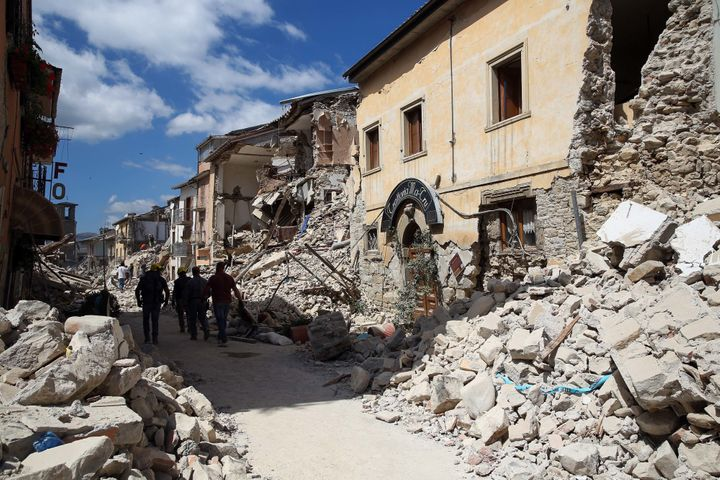 Rescue workers search for survivors in the rubble following an earthquake in Amatrice, Italy, on Wednesday, August 24, 2016.