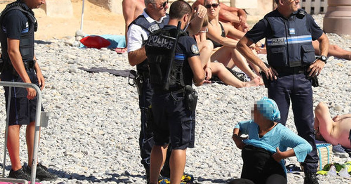 Photos Of Burkini Ban Enforcement  Show Frightening Reality Of Policing Women's Bodies