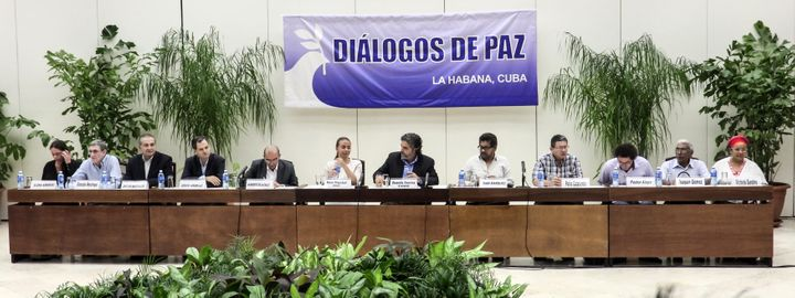 Members of the Colombian government's and FARC leftist guerrilla's delegations and guarantors for peace talks attend a press