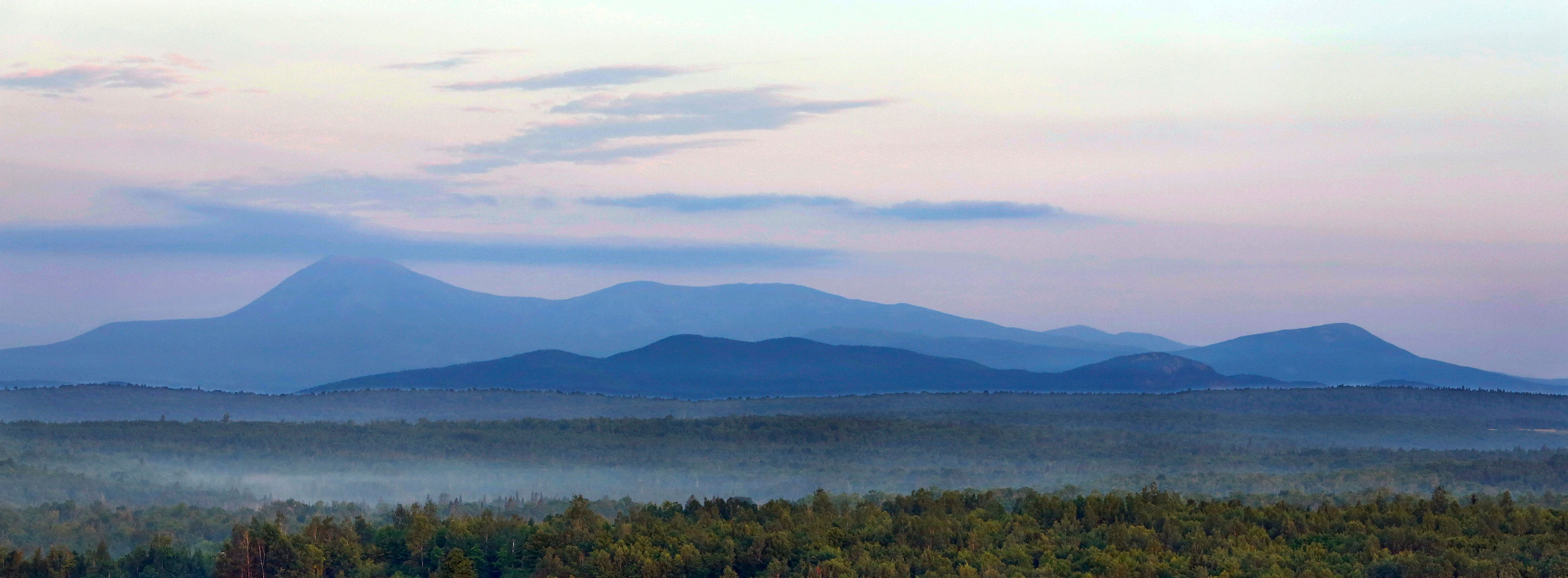 PATTEN, ME - July 15: Early morning haze colors Mount Katahdin and its surrounding mountains on Tuesday, July 15, 2014, seen from a height of land along Route 11 in Patten. The viewpoint is part of the Katahdin Woods & Waters scenic byway. (Photo by Gregory Rec/Portland Press Herald via Getty Images)