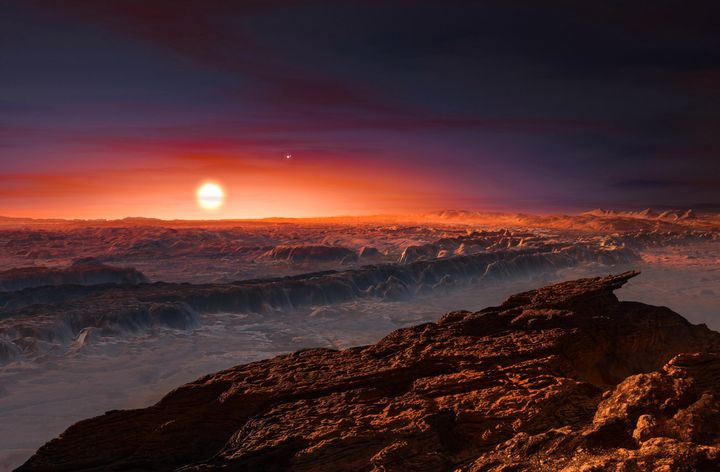 Artist's impression shows a view of the surface of planet Proxima b orbiting the red dwarf star Proxima Centauri, the closest