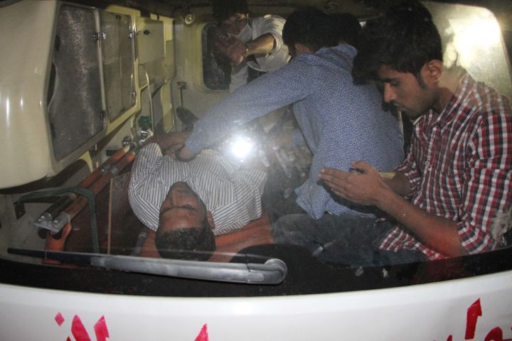 A wounded person receives treatment in an ambulance near the site of an explosion that targeted American University.