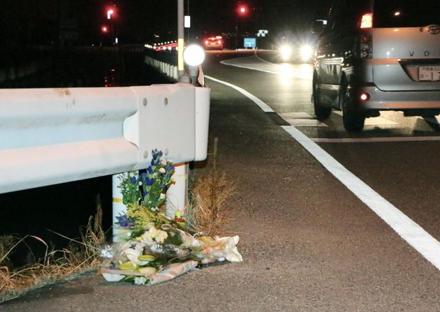 Flowers are laid near the scene where a passer-by was killed after being hit by a driver who was allegedly...