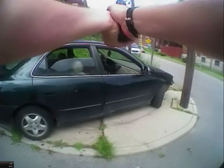 University of Cincinnati police officer Ray Tensing's body camera shows his handgun drawn at a car that came to a stop after he shot the driver, Samuel Dubose, during a traffic stop in Cincinnati on July 19, 2015.
