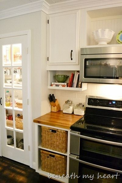 "<i><a href=""http://www.beneathmyheart.net/2012/04/our-diy-under-the-cabinet-cook-book-holder/?utm_source=rss&amp;utm_medium=r"