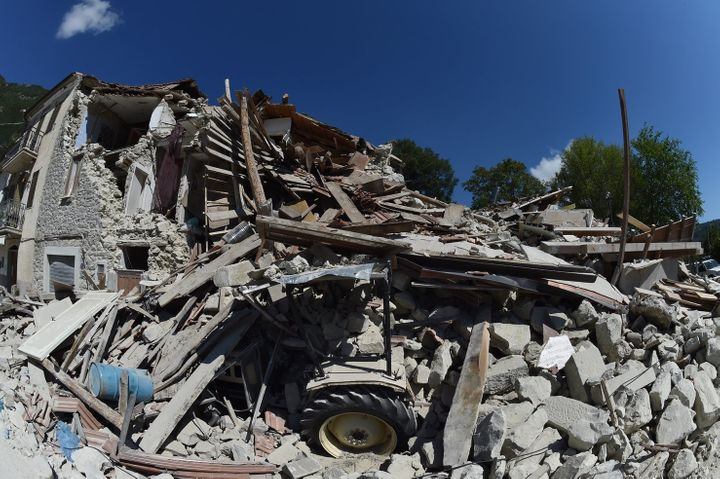 PESCARA DEL TRONTO, ITALY - AUGUST 25: Rubble surrounds a damaged building on August 25, 2016 in Pescara del Tronto, Italy.