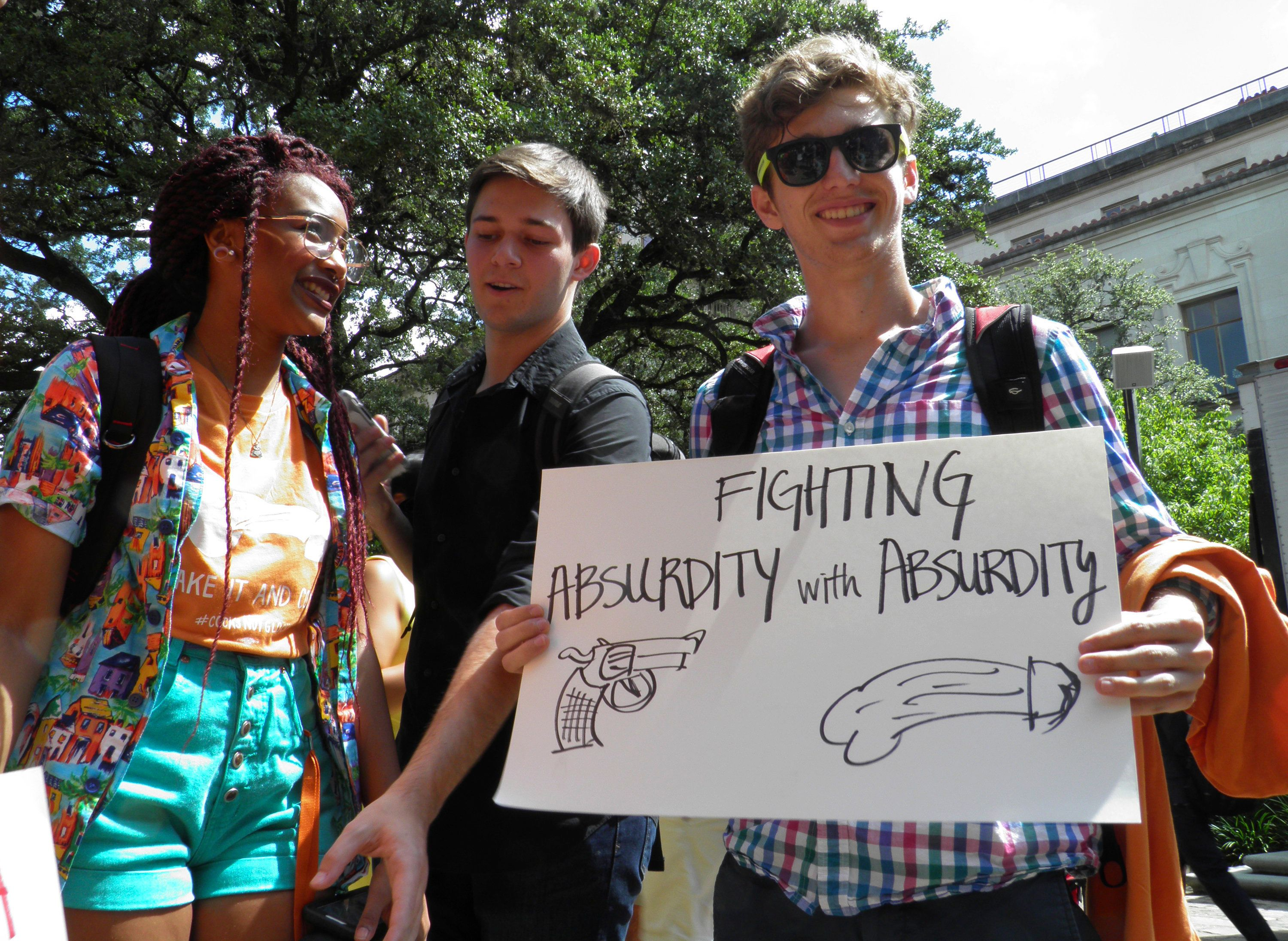 A University of Texas students attend a protest against a state law that allows for guns in classrooms at college campuses, in Austin, Texas, U.S. August 24, 2016.  At the rally, students at the University of Texas openly displayed sex toys, an act considered illegal under local indecency laws.   REUTERS/Jon Herskovitz  TEMPLATE OUT
