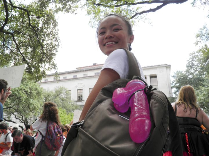 Jessica Jin, leader of the protests called ?Cocks not Glocks?, is seen at a protest against a state law that allows for guns in classrooms at college campuses, in Austin, Texas.