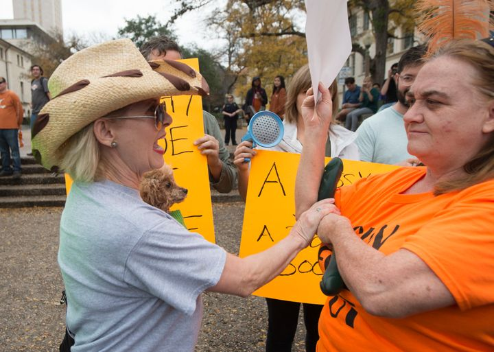 Two women clash over a sex toy at a previous protest in the spring 2016 semester, as groups in favor and opposed to guns allowed anywhere on Texas college campuses clashed Saturday drawing fewer than 200 people.