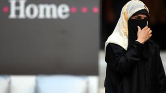 MUNICH, GERMANY - AUGUST 05:  A woman covered in a burqa is pictured prior the Beckenbauer Cup match between FC Bayern Muenchen and Inter Milan at the Allianz Arena on August 5, 2008 in Munich, Germany.  (Photo by Patrik Stollarz/Bongarts/Getty Images)