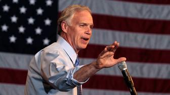 U.S. Senate Republican candidate Ron Johnson speaks to supporters during an election night party at the Experirmental Aircraft Association Museum at Wittman Field in Oshkosh, Wisconsin November 2, 2010. Three-term U.S. Senator Russ Feingold lost his re-election bid in Wisconsin on Tuesday to Republican Ron Johnson, the NBC TV network projected. REUTERS/Allen Fredrickson     (UNITED STATES - Tags: ELECTIONS POLITICS)