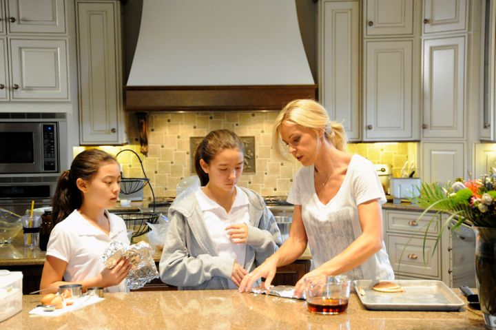 "Kate Gosselin appears on ""Celebrity Wife Swap"" Season 2, which debuted in February 2013, with daughters Cara and Mady Gosseli"