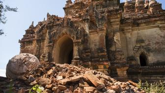 The damaged ancient Myauk Guni Temple is pictured, after a 6.8 magnitude earthquake hit Bagan, on August 25, 2016. A powerful 6.8 magnitude earthquake struck central Myanmar on August 24, killing at least three person and damaging pagodas in the ancient city of Bagan, officials said. The quake, which the US Geological Survey said hit at a depth of 84 kilometres (52 miles), was also felt across neighbouring Thailand, India and Bangladesh, sending panicked residents rushing onto the streets. / AFP / YE AUNG THU        (Photo credit should read YE AUNG THU/AFP/Getty Images)
