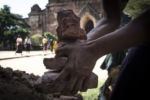 A man collects the pieces of bricks of Dhammayangyi temple after earthquake in ancient Bagan city, Myanmar on August 25, 2016